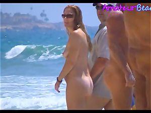 first-timer naturist Beach duo walking Along The Beach