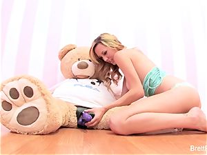 Brett Rossi plays with a plunged bear's strap-on fake penis