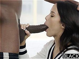 Megan Rain pulverizing a ebony man rod