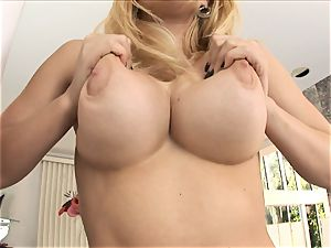 light-haired honey Kagney Karter plays with her giant breasts