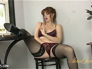 Amber Dawn delights herself wearing thigh highs.